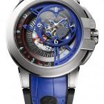 Harry Winston Ocean Dual Time Retrograde Only Watch: 18К белое золото, автоподзавод, 44,2 мм, частично скелетонированный многоуровневый циферблат, по форме стилизованный под четырехконечную звезду сюрикен, ретроградная индикация времени.