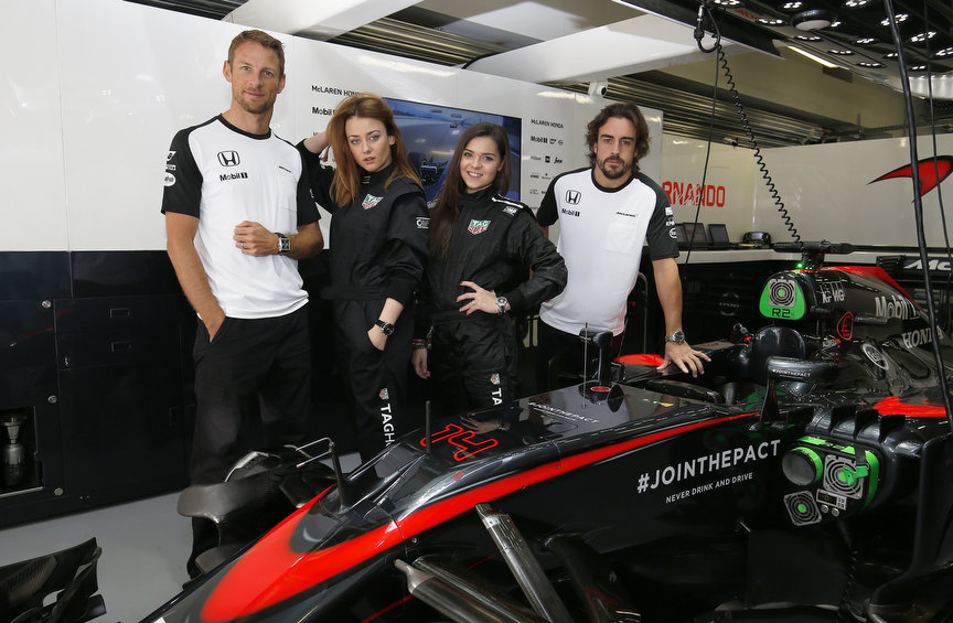 Sochi Autodrom, Sochi, Russia. Sunday 11 October 2015. Jenson Button, McLaren, Fernando Alonso, McLaren, Adelina Sotnikova, Olympic Figure Skater, and Ingrid Olerinskaya, Actress. World Copyright: Steven Tee/LAT Photographic ref: Digital Image _L4R4898